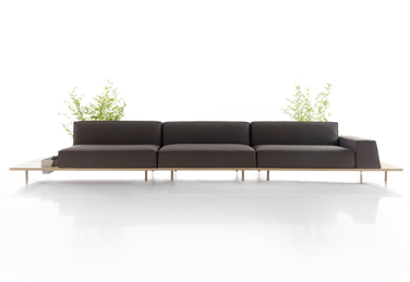 Mus sofa with wooden ledge by Francesc Rifé has clear Nordic influences
